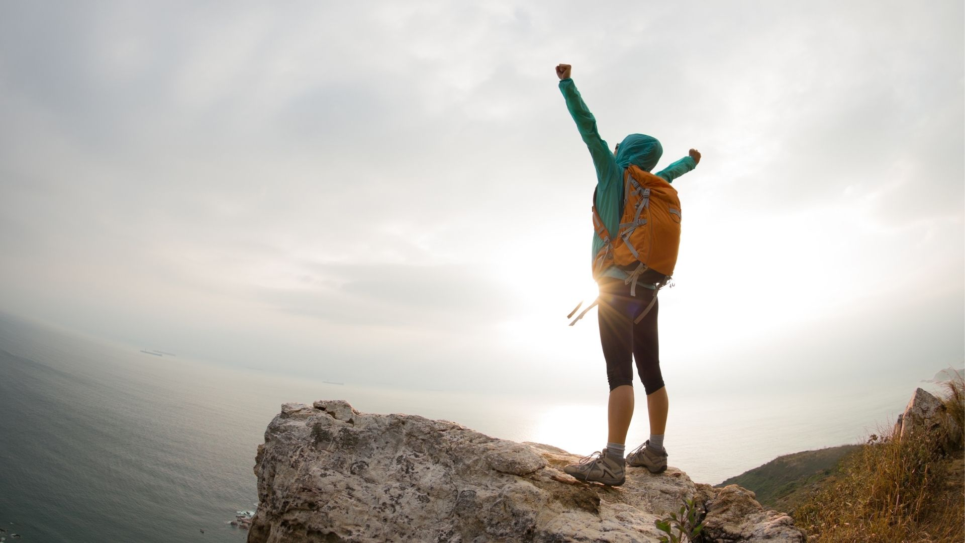 Joy of reaching the summit of a mountain after a hike