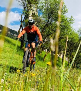 Peter Fill mountain biking in the dolomites